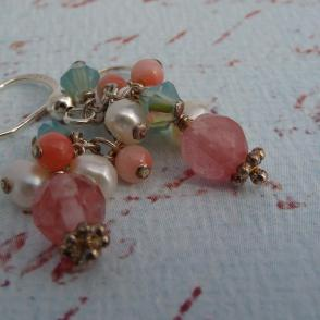 coral, pearl, and quartz earrings with a beachy-vintage feel