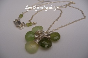 Jade and peridot with sterling 'Cleopatra' wrap, dangling beautifully from a heart chain with peridot accents.